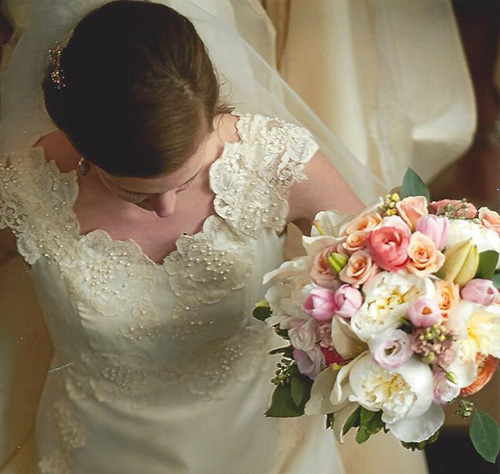 bride in wedding dress with floral arrangements from Waukesha floral