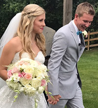 bride and groom with floral arrangements from Waukesha floral