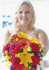 happy bride with floral boquet from Waukesha Floral