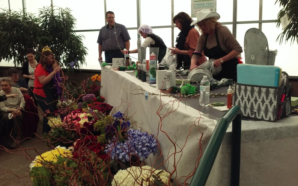 Waukesha Floral designers competing on stage by designing beautiful flower arrangement as quickly as possible!