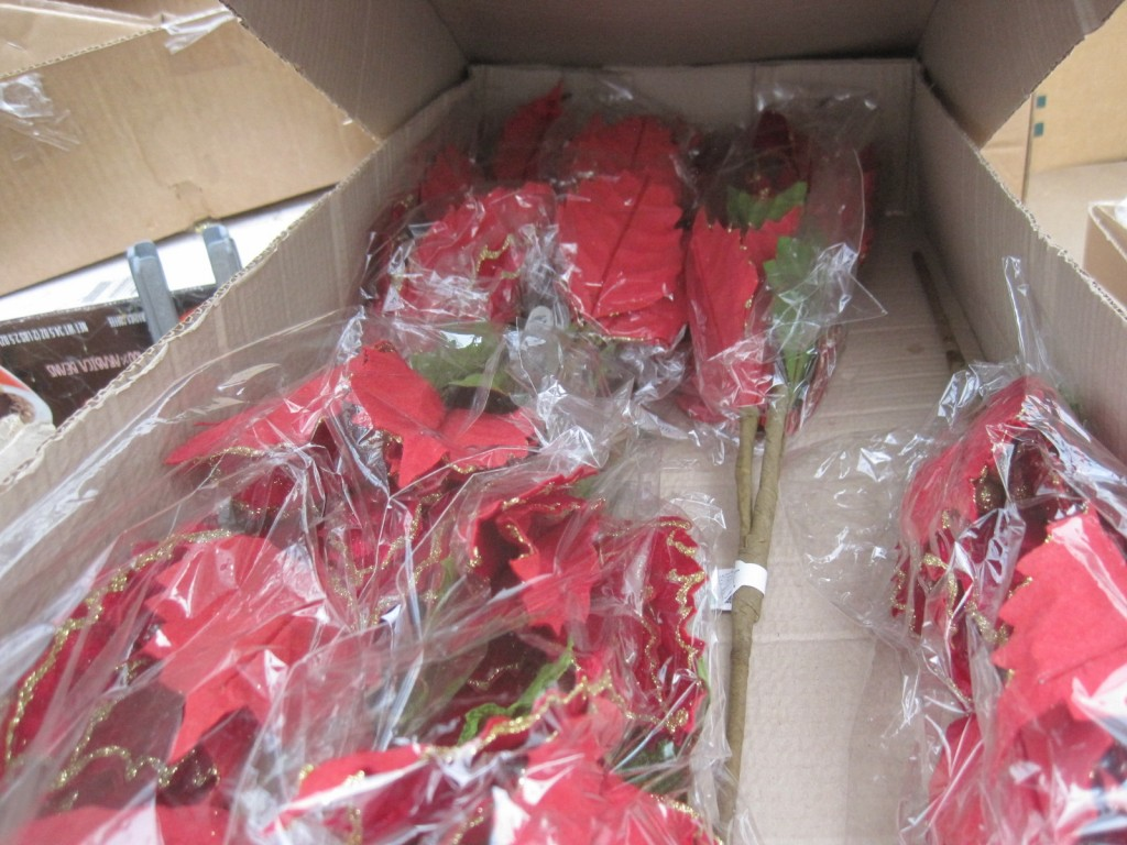 These poinsettia stems will be nice. They are velvet with a gold edge and centers, and each stem contains 3 flowers. I will unwrap and unfold the petals, clip the stems back for less weight, and distribute these evenly from top to bottom on my tree.