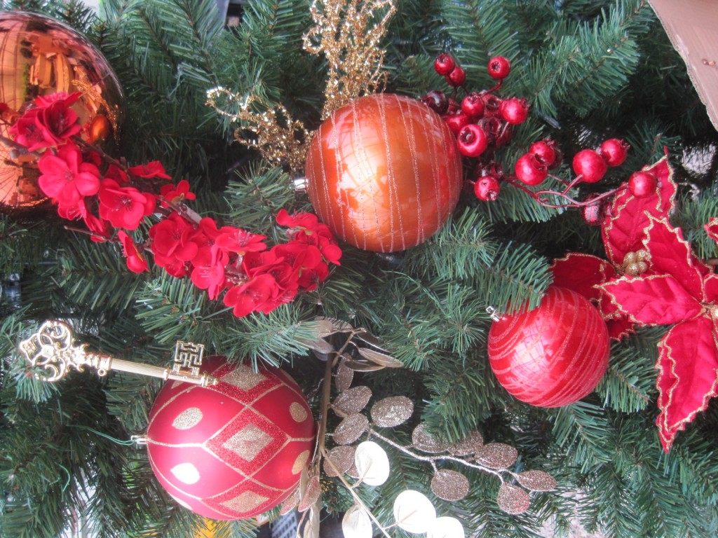 "Now I take everything I have chosen for my tree and do a ""test decorating"" to see if the decorations play well together. I am looking for a red and copper tree with gold accents, a rich yet vibrant look. I think these work!"