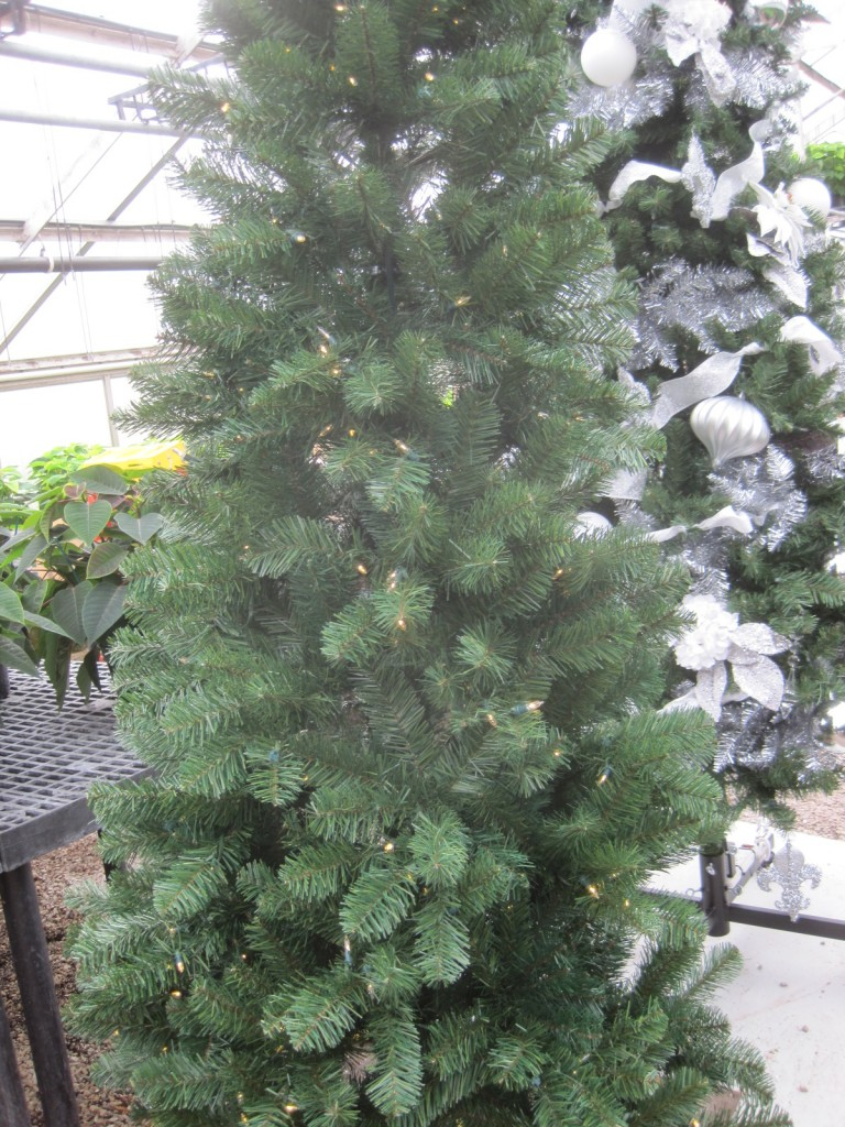 "Start with a permanent, pre-lighted tree. Assemble the tree and pull all the pine tips on the branches so each is going out in different directions. We call this ""fluffing""!"
